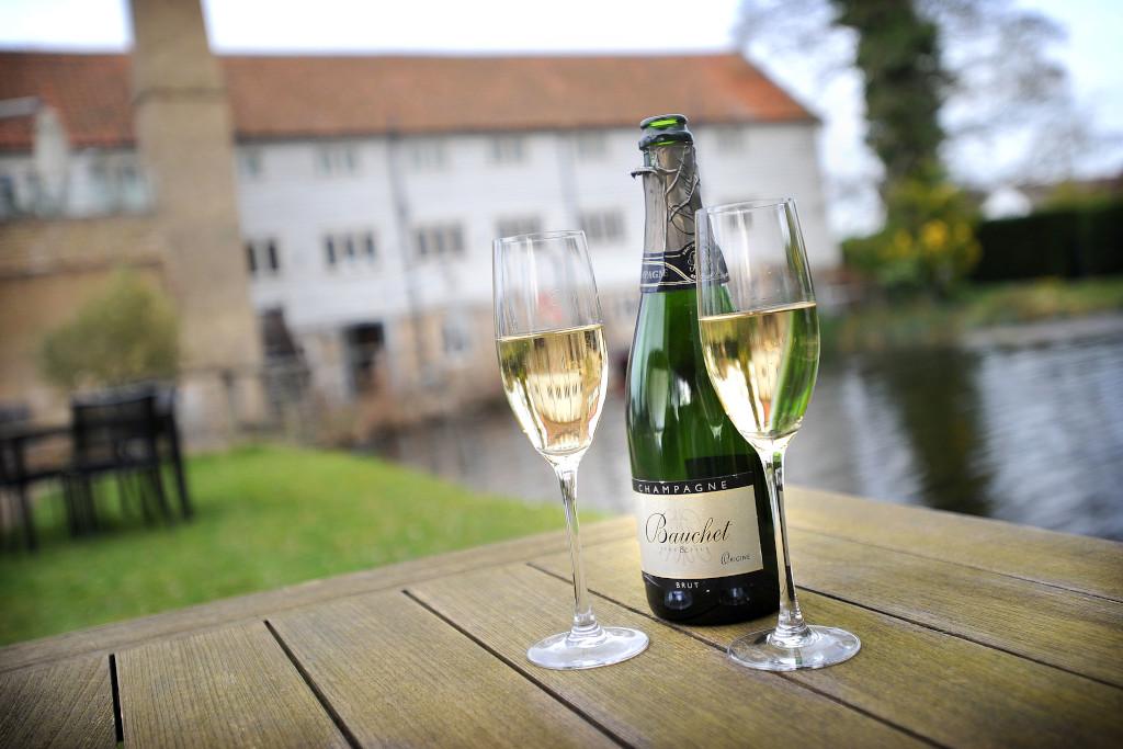 champagne in the garden at Tuddenham Mill
